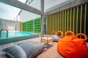 The swimming pool at or near Recenta Style Phuket Town - SHA Plus