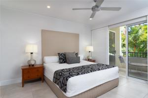 A bed or beds in a room at Mandalay Luxury Beachfront Apartments