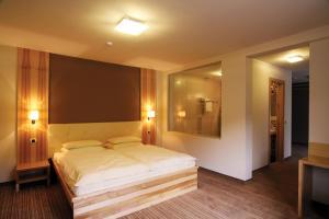 Postelja oz. postelje v sobi nastanitve Hotel Dras