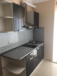 Кухня или мини-кухня в Мини-Отель Русалина