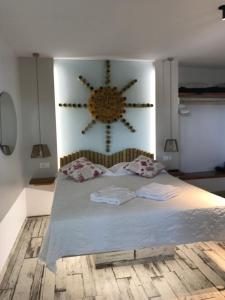 Ένα ή περισσότερα κρεβάτια σε δωμάτιο στο Fraskoula's Beach
