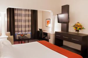 A television and/or entertainment center at Holiday Inn Express Hotel & Suites Pittsburgh-South Side, an IHG Hotel