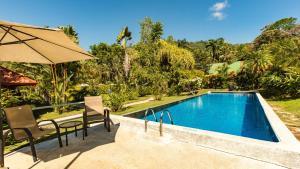 The swimming pool at or near Hotel Villas Rio Mar
