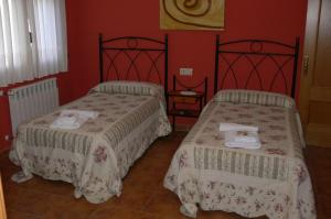 A bed or beds in a room at Casa Mariví