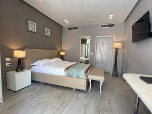 A bed or beds in a room at Velipoja Grand Europa Resort
