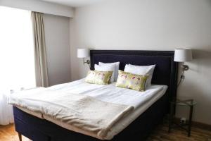 Säng eller sängar i ett rum på Mora Hotell & Spa