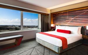 A bed or beds in a room at Crowne Plaza JFK Airport New York City, an IHG Hotel