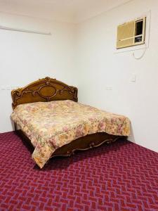 Cama ou camas em um quarto em سحاب أبها