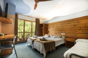 Cama o camas de una habitación en Hotel Restaurant Les Brases