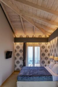 Letto o letti in una camera di Petani Bay Hotel - Adults Only