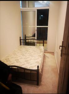A bed or beds in a room at Amazing Small Homestay room near to Media Rotana Hotel