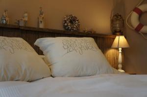 Un ou plusieurs lits dans un hébergement de l'établissement B&B Oesterhoeve
