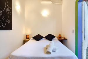 A bed or beds in a room at A Casa de Paulo Autran