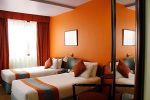 Кровать или кровати в номере Al Diar Dana Hotel