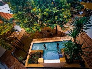 A view of the pool at Villetta House Syariah or nearby