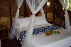 Cama ou camas em um quarto em Pension TUPUNA