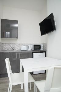 A television and/or entertainment center at TLK Apartments & Hotel - Beckenham High Street