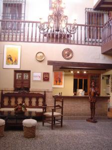 El vestíbulo o zona de recepción de Hotel Mesón de Don Quijote