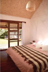 Cama o camas de una habitación en Ñangapiré Posada de Campo