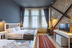 A bed or beds in a room at Hotel Miro Mansion Istanbul