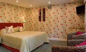 A bed or beds in a room at Waren House Hotel Northumberland