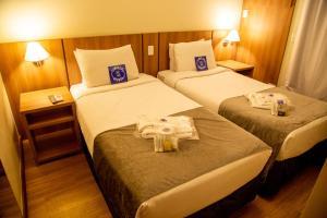 Cama ou camas em um quarto em Blue Tree Towers Millenium Porto Alegre
