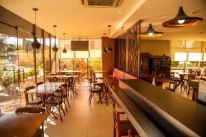 Um restaurante ou outro lugar para comer em Blue Tree Towers Millenium Porto Alegre