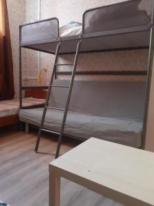 A bunk bed or bunk beds in a room at Hostel Dom