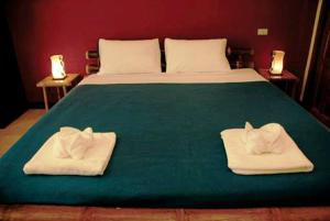 A bed or beds in a room at Garden Resort