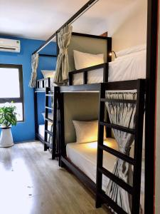 A bunk bed or bunk beds in a room at LANGCHIA HOME