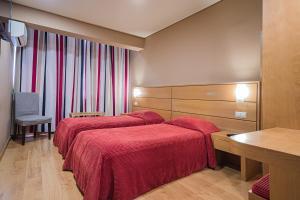 Cama o camas de una habitación en Hotel Botanico