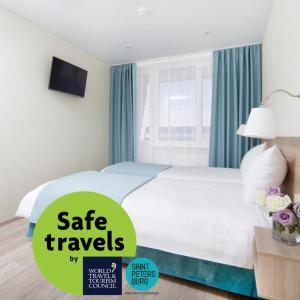 Кровать или кровати в номере Гостиница Репинская