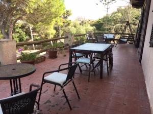 A restaurant or other place to eat at Villa Sualeddu