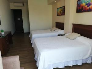 A bed or beds in a room at BLAZE Hotel & Suites