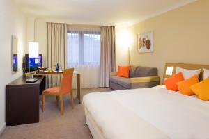 A bed or beds in a room at Novotel Bristol Centre