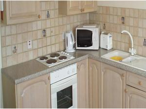 A kitchen or kitchenette at Panama Apartments