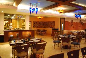 A restaurant or other place to eat at Radisson Hotel Varanasi