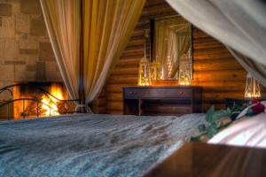 Ένα ή περισσότερα κρεβάτια σε δωμάτιο στο Το Ξύλινο Χωριό