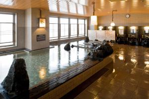 Kolam renang di atau di dekat Dormy Inn Asahikawa