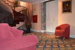 A seating area at Residencial Mariazinha by Petit Hotels