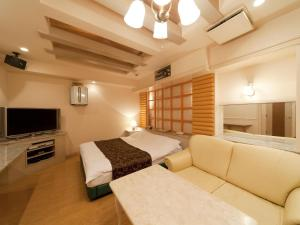 A bed or beds in a room at Hotel Fine Biwako I (Adult Only)
