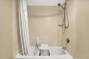 A bathroom at Wingate by Wyndham Richardson