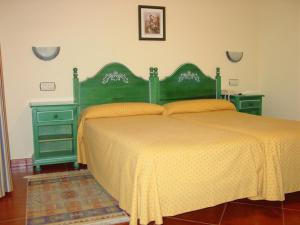 A bed or beds in a room at Hotel Gavitu