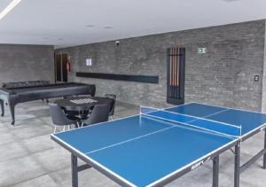 The lounge or bar area at Edifício Time - Apto 524