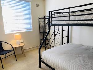 A bunk bed or bunk beds in a room at 5 'SHOAL TOWERS', 11 SHOAL BAY RD - FANTASTIC LOCATION WITH WATER VIEWS