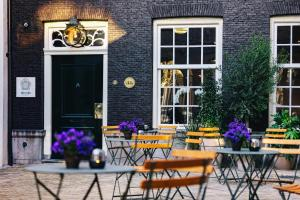A porch or other outdoor area at The Dylan Amsterdam