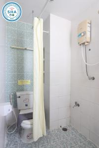 A bathroom at My Way Hua Hin Music Hotel - SHA Plus Certified -