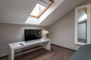 A seating area at Emporio Prague Apartments