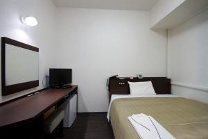 京都廣場酒店附樓房間的床