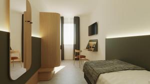 A room at Hotel Casa Del Pellegrino